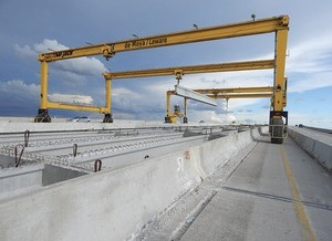 Bridge Builder Hooked on GPS-Guided Gantries